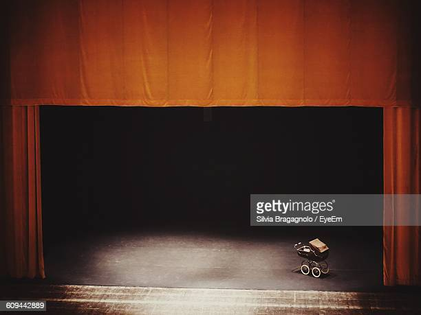 high angle view of baby stroller on stage theater - stage curtain stock pictures, royalty-free photos & images