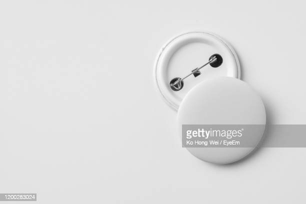 high angle view of badges against white background - バッジ ストックフォトと画像
