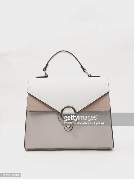high angle view of bag against white background - white purse stock pictures, royalty-free photos & images