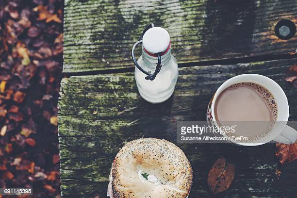 High Angle View Of Bagel And Coffee On Table During Autumn