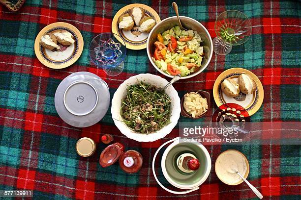high angle view of baked potato with vegetable salad - picnic blanket stock pictures, royalty-free photos & images