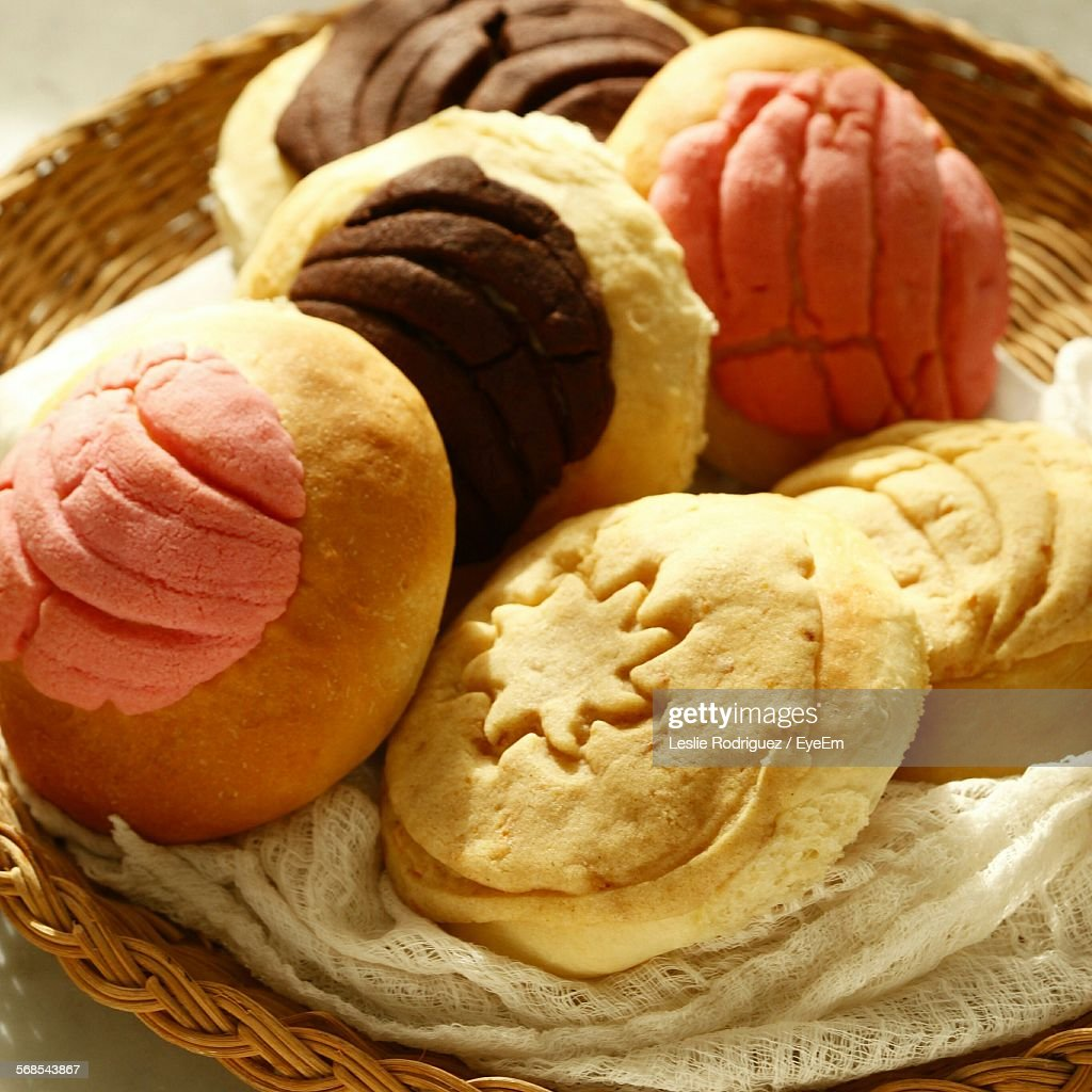 High Angle View Of Baked Sweet Food In Wicker Basket : Stock Photo