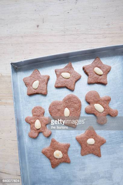 High angle view of baking sheet with Christmas cookies on table