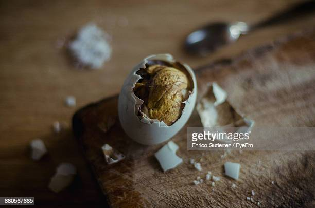 High Angle View Of Balut On Cutting Board