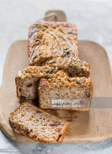 high angle view of banana breads on cutting board - banana loaf stockfoto's en -beelden