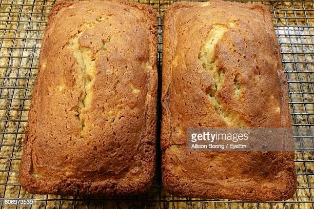 High Angle View Of Banana Breads On Metal Grate