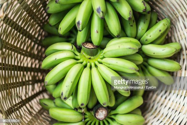high angle view of bananas for sale in basket - fruit exotique photos et images de collection