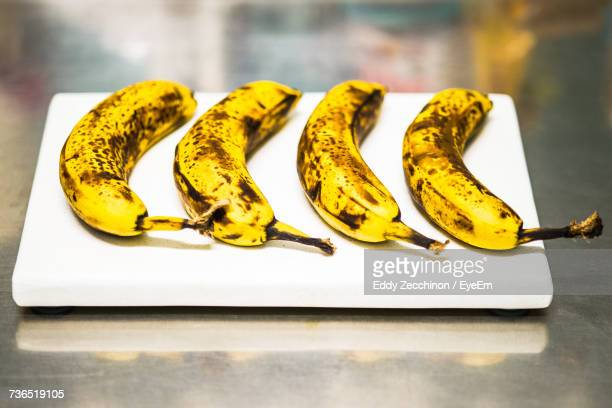 High Angle View Of Bananas On Cutting Board At Table