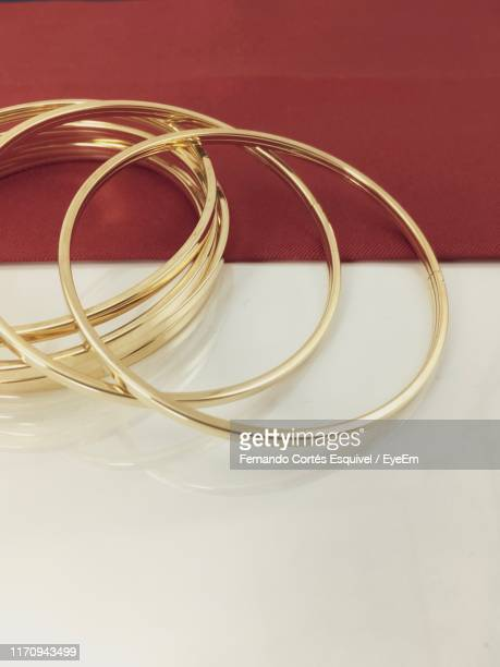 high angle view of bangles on table - bangle stock pictures, royalty-free photos & images