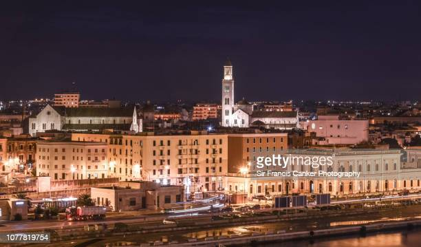 high angle view of bari skyline illuminated at night, puglia, italy - basilica di san nicola bari foto e immagini stock