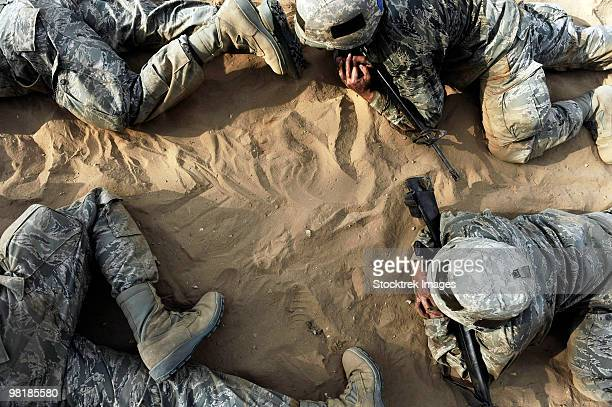 high angle view of basic trainees crawling through a tactical course. - military training stock pictures, royalty-free photos & images