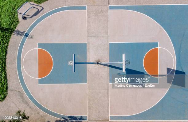 high angle view of basketball court during sunny day - basketball court stock pictures, royalty-free photos & images