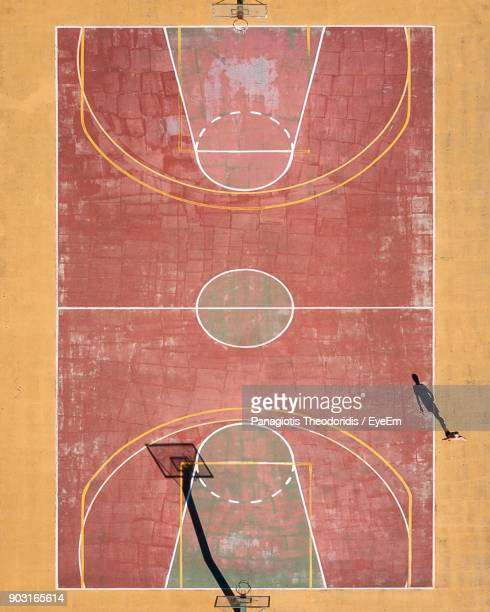 high angle view of basketball court on sunny day - brown stock pictures, royalty-free photos & images