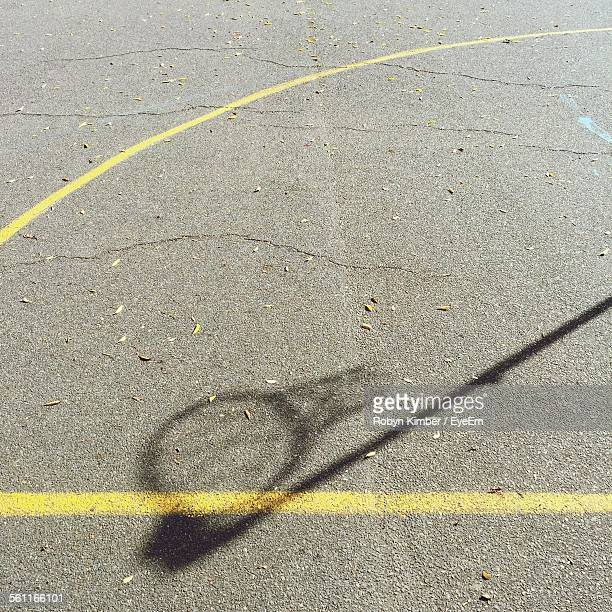 High Angle View Of Basketball Hoop Shadow On Concrete Court