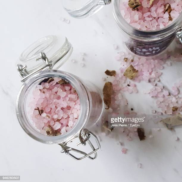 High Angle View Of Bath Salts In Jars On Table