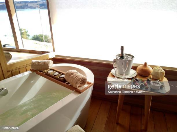 High Angle View Of Bathtub By Food And Drink In Bathroom