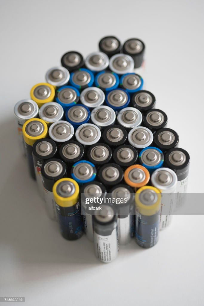 High angle view of batteries on white table : Stock Photo