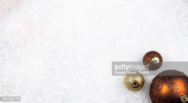 high angle view of baubles on snow - fake snow stock pictures, royalty-free photos & images