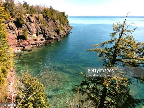 high angle view of bay against clear sky - munising michigan stock pictures, royalty-free photos & images