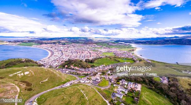 high angle view of bay against sky - llandudno wales stock pictures, royalty-free photos & images