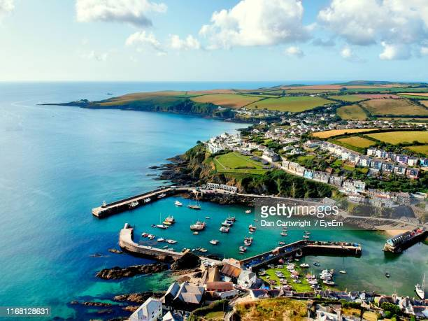 high angle view of bay against sky - mevagissey stock photos and pictures