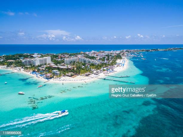high angle view of beach against blue sky - isla mujeres ストックフォトと画像