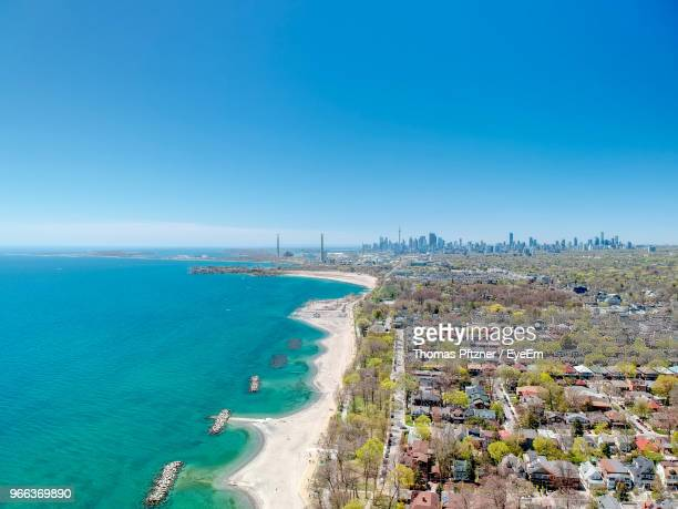 high angle view of beach against blue sky - lake ontario stock pictures, royalty-free photos & images