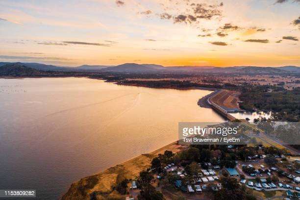 high angle view of beach against sky during sunset - town stock pictures, royalty-free photos & images