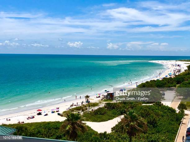 high angle view of beach against sky - sarasota stock photos and pictures