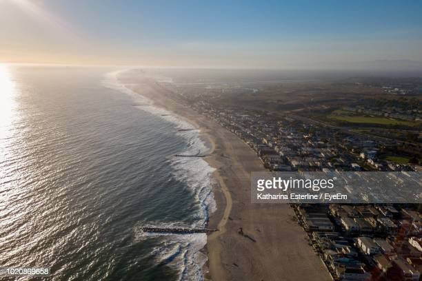 high angle view of beach against sky - newport beach stock pictures, royalty-free photos & images