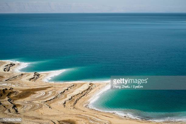 high angle view of beach against sky - dead sea stock pictures, royalty-free photos & images