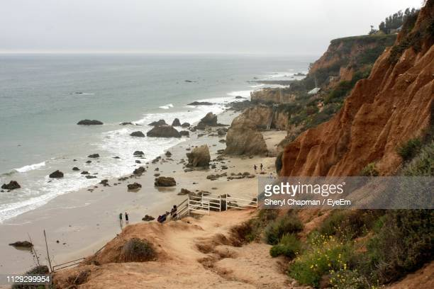 high angle view of beach against sky - malibu beach stock pictures, royalty-free photos & images