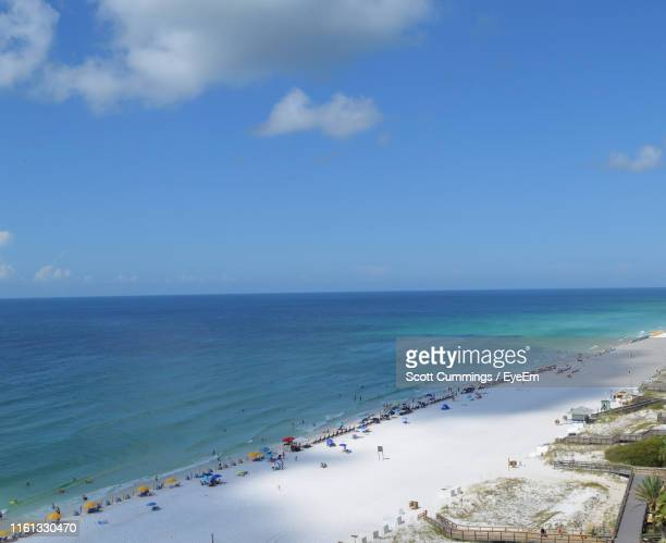 high angle view of beach against sky - destin beach stock pictures, royalty-free photos & images