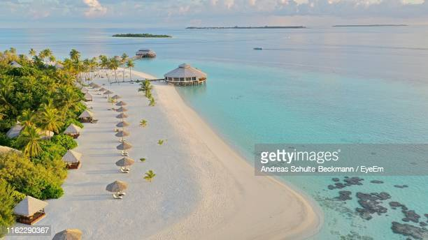high angle view of beach against sky - maldives stock pictures, royalty-free photos & images