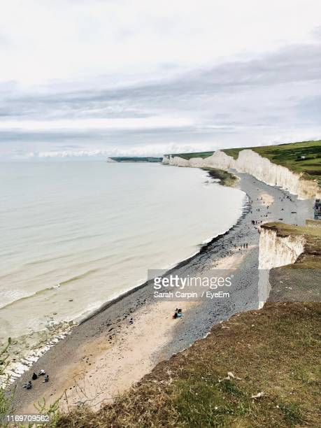 high angle view of beach against sky - sarah sands stock pictures, royalty-free photos & images