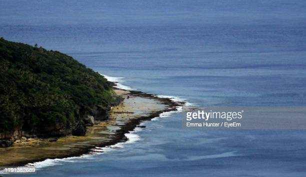 high angle view of beach against sky - emma hunter eye em stock photos and pictures
