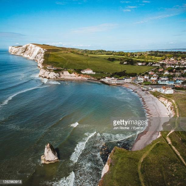 high angle view of beach against sky - freshwater bay isle of wight stock pictures, royalty-free photos & images