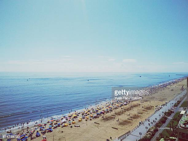 high angle view of beach against sky - virginia beach stock photos and pictures