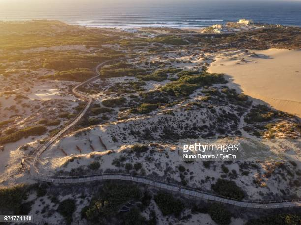 high angle view of beach against sky - cascais stock photos and pictures