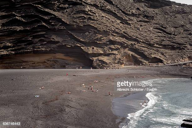 high angle view of beach and mountains - albrecht schlotter foto e immagini stock
