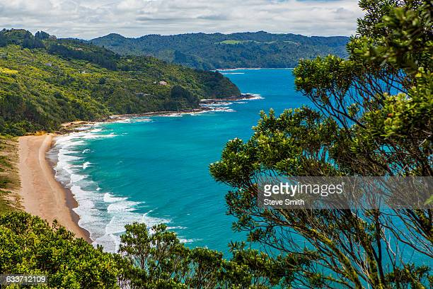 High angle view of beach and remote mountainside
