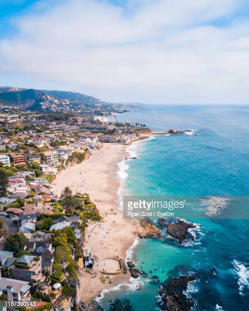 high angle view of beach by buildings - orange county crowded beaches stock pictures, royalty-free photos & images