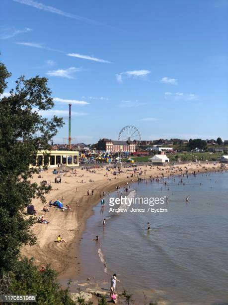 high angle view of beach by sea against sky - wales stock pictures, royalty-free photos & images