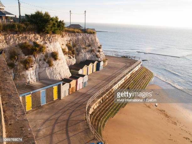 high angle view of beach huts against sky - kent england stock pictures, royalty-free photos & images