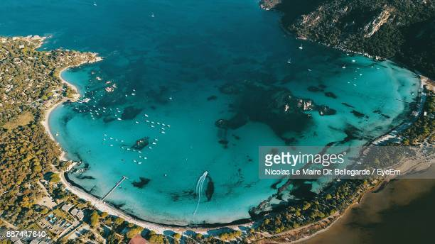 high angle view of beach on sunny day - corsica stock-fotos und bilder