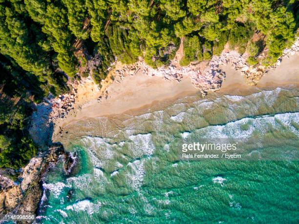 high angle view of beach - tarragona stock photos and pictures