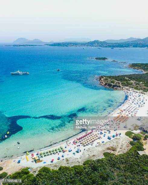 high angle view of beach - costa smeralda stock pictures, royalty-free photos & images