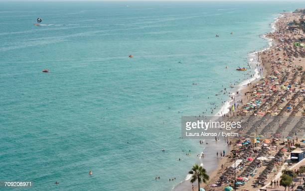 high angle view of beach - fuengirola stock photos and pictures