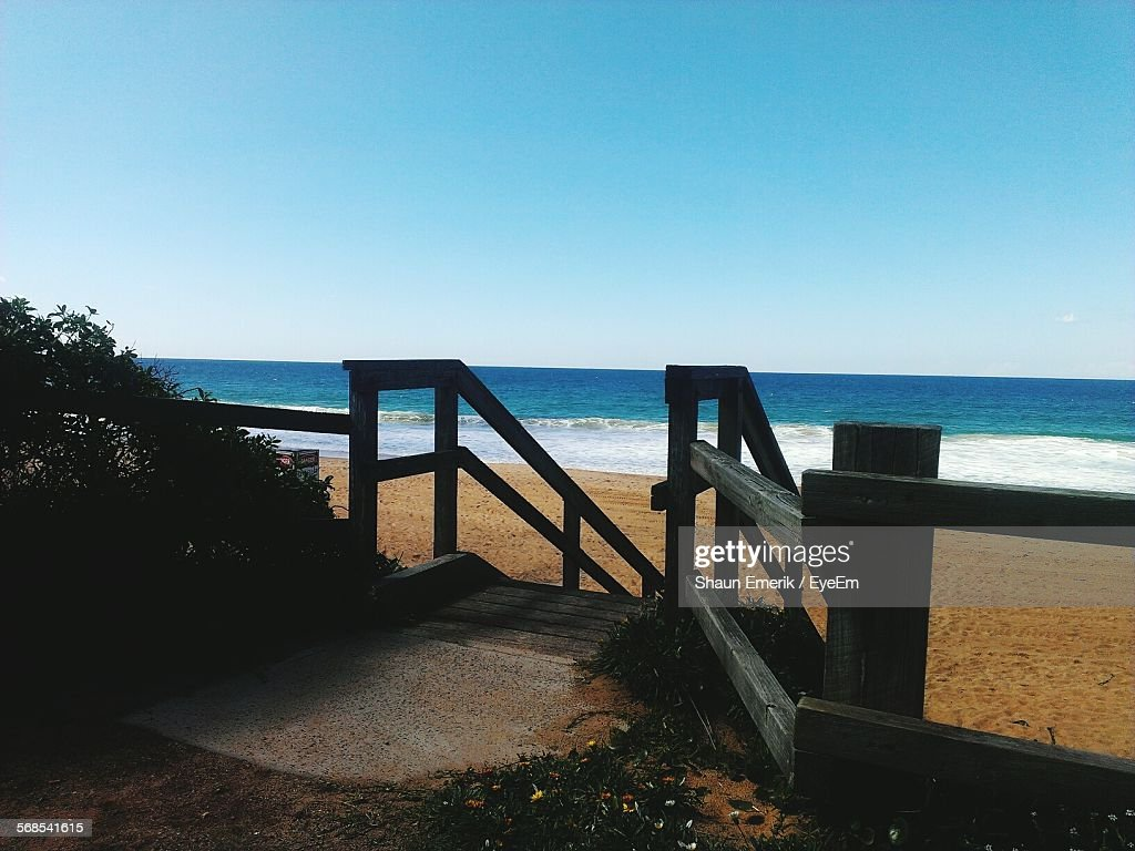 High Angle View Of Beach Seen From Log Cabin Against Clear Blue Sky : Stock Photo