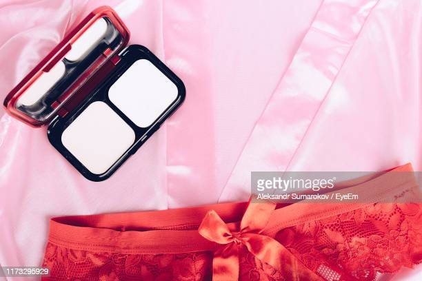 high angle view of beauty product with panties on textile - mutandine foto e immagini stock